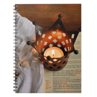 Christmas candle and bible notebooks