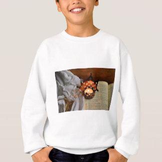 Christmas candle and bible sweatshirt