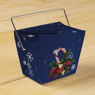 Christmas candy cane in a mistletoe and holly berr favor box
