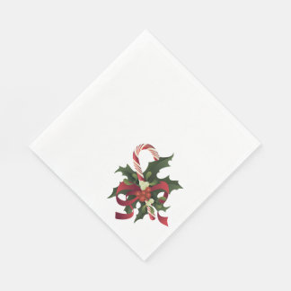 Christmas candy cane in a mistletoe and holly berr napkin