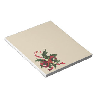 Christmas candy cane in a mistletoe and holly berr notepad