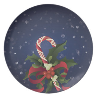 Christmas candy cane in a mistletoe and holly berr plate