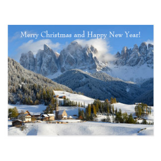 Christmas card with dolomite village in winter