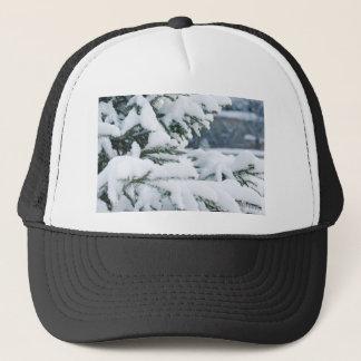 Christmas eve tree snowing trucker hat