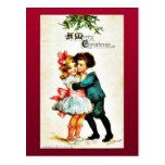 Christmas greeting with a boy hugs a girl postcards