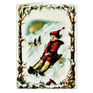 Christmas greeting with a boy snow slading greeting card