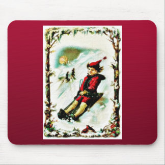 Christmas greeting with a boy snow slading mouse pad