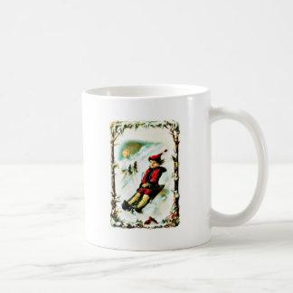 Christmas greeting with a boy snow slading mug