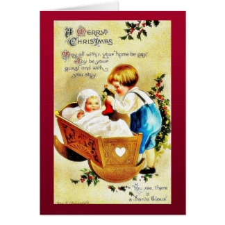 Christmas greeting with a child in a caddle and th card