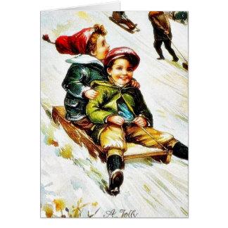 Christmas greeting with kids snow slading greeting card