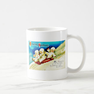 Christmas greeting with three kids snow slading mug