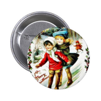 Christmas greeting with two kids snow slading in a pinback button