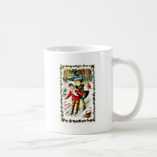 Christmas greeting with two kids snow slading in a coffee mugs