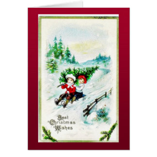 Christmas greeting with with two kids snow slading greeting card