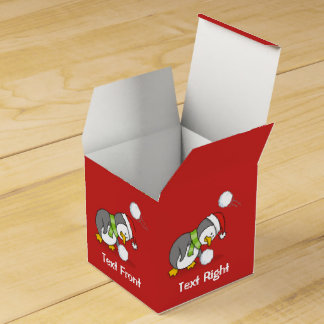 Christmas penguin getting a snow ball favor box