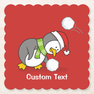 Christmas penguin getting a snow ball paper coaster