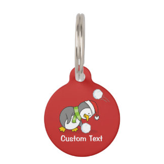 Christmas penguin getting a snow ball pet name tag