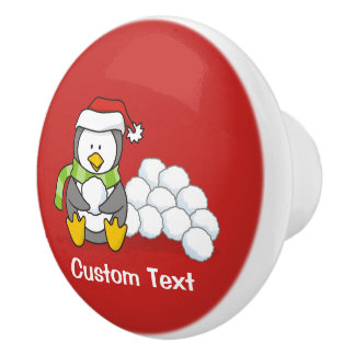 Christmas penguin sitting with snow balls ceramic knob