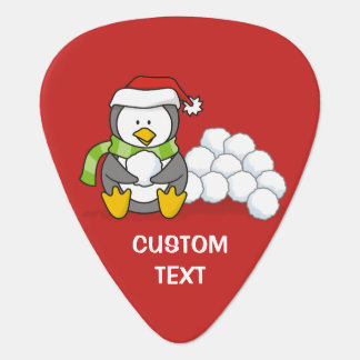 Christmas penguin sitting with snow balls guitar pick