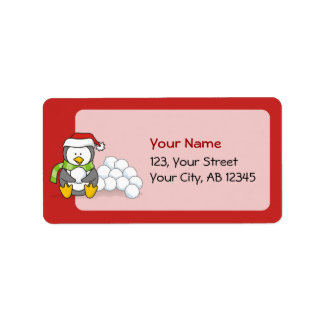 Christmas penguin sitting with snow balls label