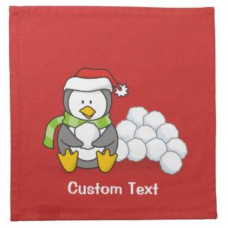 Christmas penguin sitting with snow balls napkin