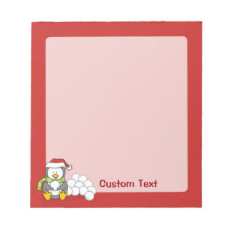Christmas penguin sitting with snow balls notepad