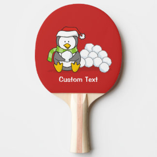 Christmas penguin sitting with snow balls ping pong paddle