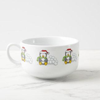 Christmas penguin sitting with snow balls soup mug