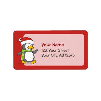 Christmas penguin walking on snow label