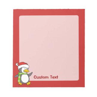 Christmas penguin walking on snow notepad