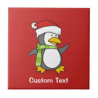Christmas penguin walking on snow tile