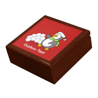 Christmas penguin with snow balls waving gift box