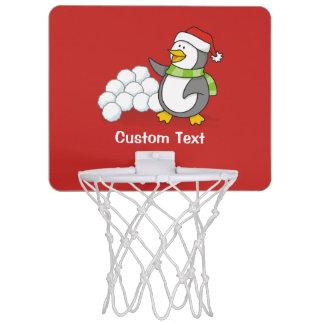 Christmas penguin with snow balls waving mini basketball hoop