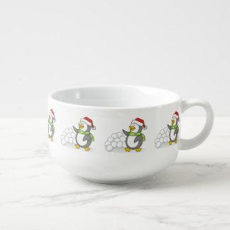 Christmas penguin with snow balls waving soup mug
