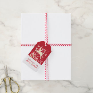 Christmas reindeer prancing over gifts red tag
