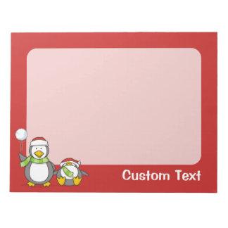 Christmas Snowballing penguins Notepad