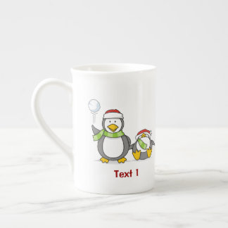 Christmas Snowballing penguins Tea Cup