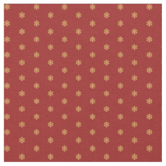 Christmas snowflake pattern gold on red background fabric