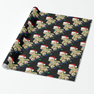 Christmas teddy bear tangled in lights wrapping paper