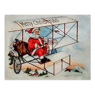 Christmas Vintage Santa on airplane Postcard
