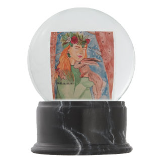 Christmas witch and her rabbit snow globe
