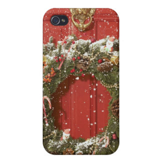 Christmas wreath hanging on a door case for iPhone 4