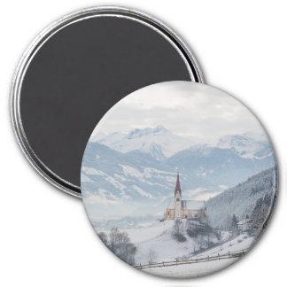 Church in Zillertal in winter round magnet
