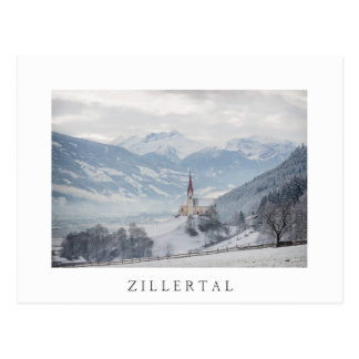 Church in Zillertal in winter white text postcard