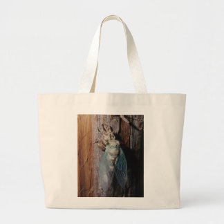 Cicada dries his wings large tote bag
