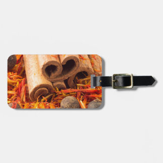 Cinnamon, peppercorn and saffron close-up luggage tag
