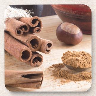 Cinnamon sticks and powder coaster
