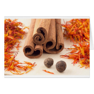 Cinnamon sticks, aromatic saffron and pimento card