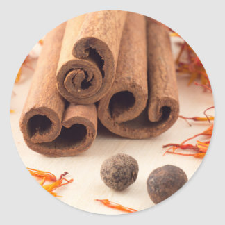 Cinnamon sticks, aromatic saffron and pimento classic round sticker