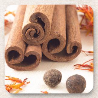 Cinnamon sticks, aromatic saffron and pimento coasters